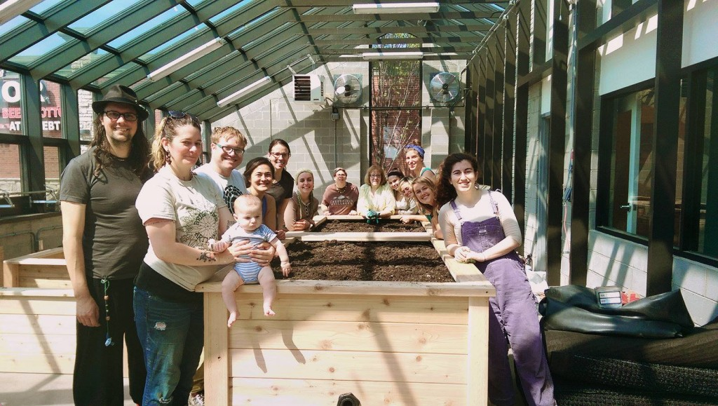 Some of our dedicated volunteers after filling raised beds with an organic soil mix.